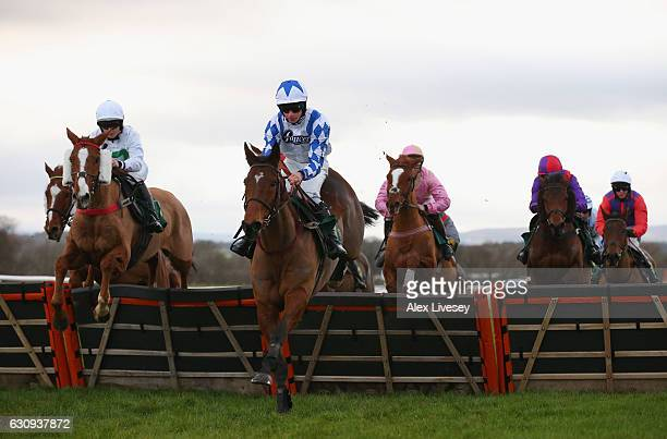 Becauseshesaidso ridden by Charlie Deutsch jump a fence during the Stella Artois 4% Handicap Race Hurdle Race at BangorOnDee Racecourse on January 3...