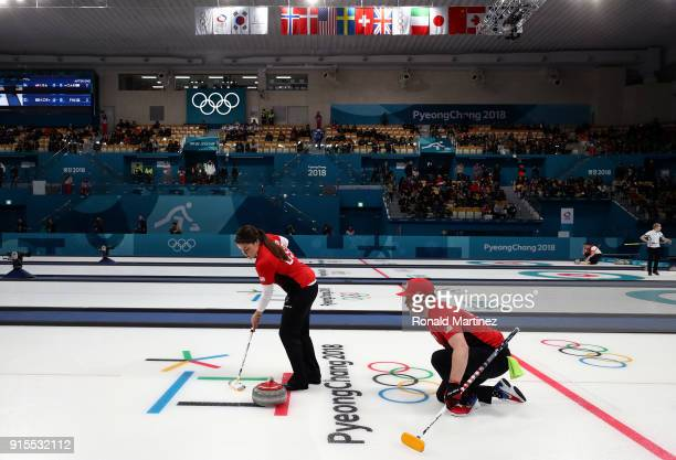 Becca Hamilton and Matt Hamilton of the United States deliver a stone in the Curling Mixed Doubles Round Robin Session 1 during the PyeongChang 2018...
