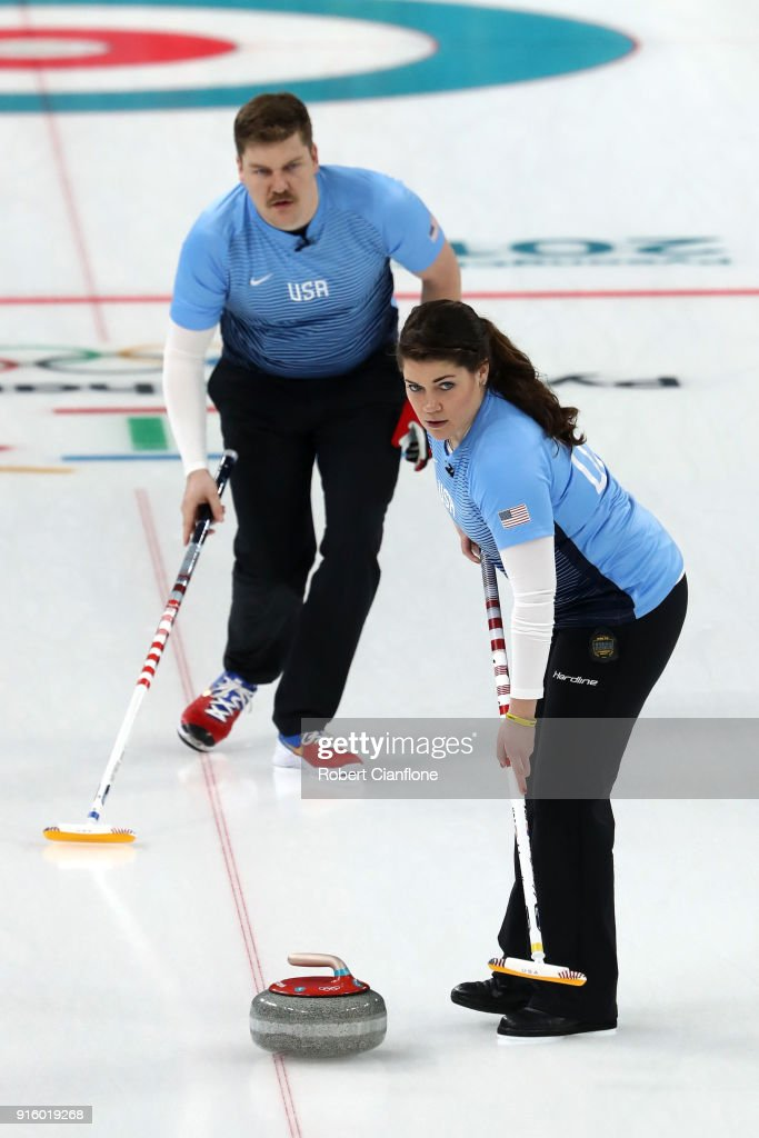 Becca Hamilton and Matt Hamilton of the United States deliver a stone against Kijeong Lee and Hyeji Jang of Korea during the Curling Mixed Doubles Round Robin match ahead of the PyeongChang 2018 Winter Olympic Games at Gangneung Curling Centre on February 9, 2018 in Gangneung, South Korea.