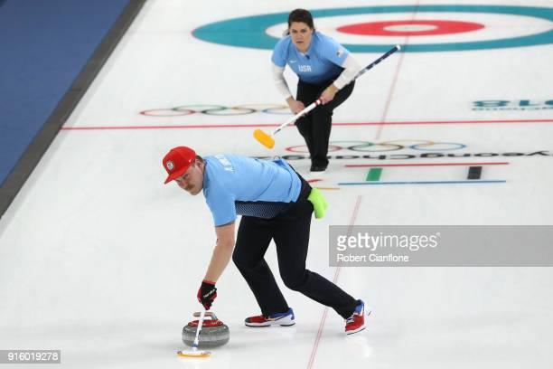 Becca Hamilton and Matt Hamilton of the United States deliver a stone against Kijeong Lee and Hyeji Jang of Korea during the Curling Mixed Doubles...