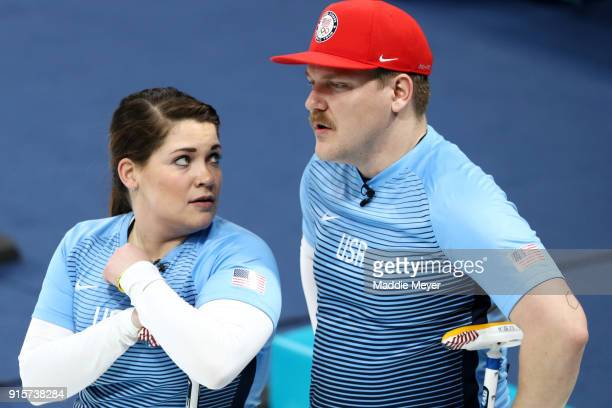 Becca Hamilton and Matt Hamilton of the United States of America talk during their game against Canada in the Curling Mixed Doubles Round Robin...