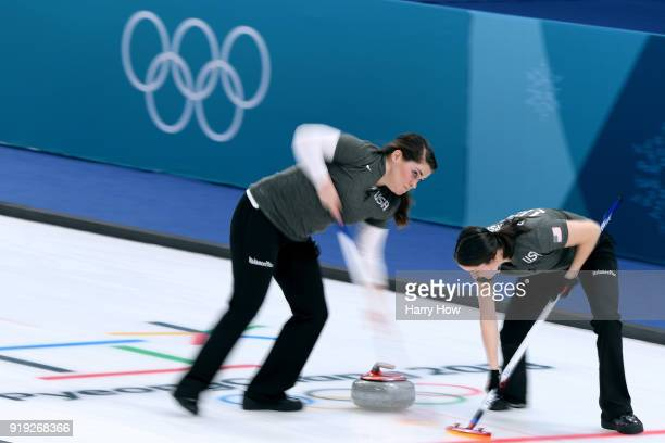 Becca Hamilton and Tabitha Peterson of the United States sweep in a match against Canada during the Women's Curling Round Robin on day eight of the...