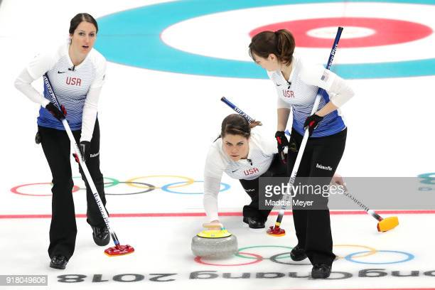 Becca Hamilton of the United States of America casts a stone between teammates Tabitha Peterson left and Aileen Geving during the game against Japan...