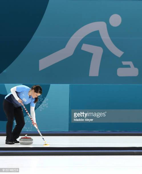 Becca Hamilton of the United States of America sweeps the ice during the game against Canada in the Curling Mixed Doubles Round Robin Session 2...