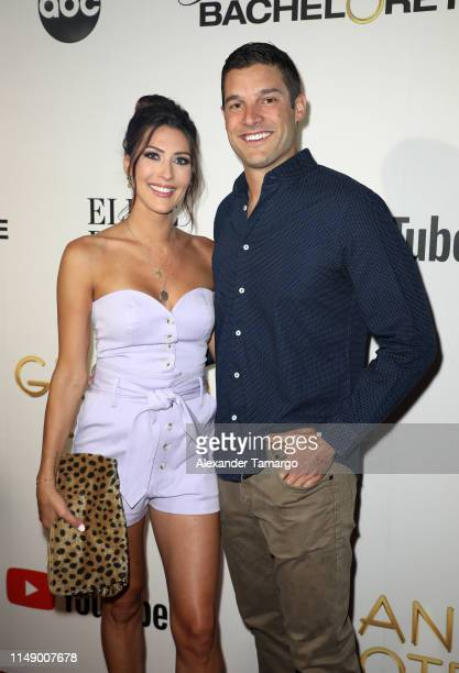Becca Kufrin and Garrett Yrigoyen are seen at ABC's Grand Hotel Premiere on June 10 2019 in Miami Beach Florida