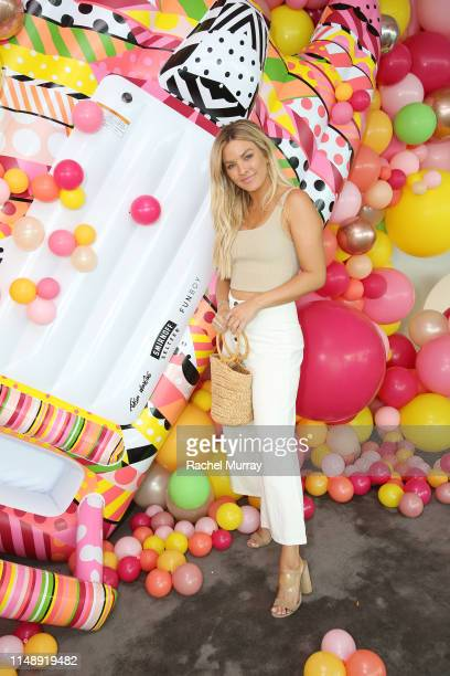 Becca Tilley helps launch the 'must have' Smirnoff Seltzer x FUNBOY pool float of the summer designed by artist Jason Woodside at the Smirnoff...
