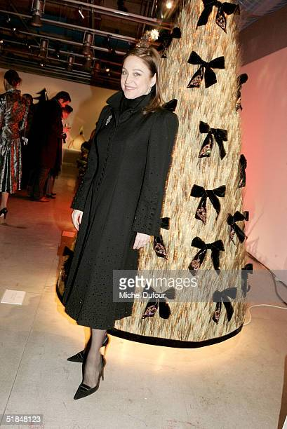 Becca Trash poses with the YSL tree at a private party featuring christmas trees created by fashion designers held at the Centre Pompidou December 10...