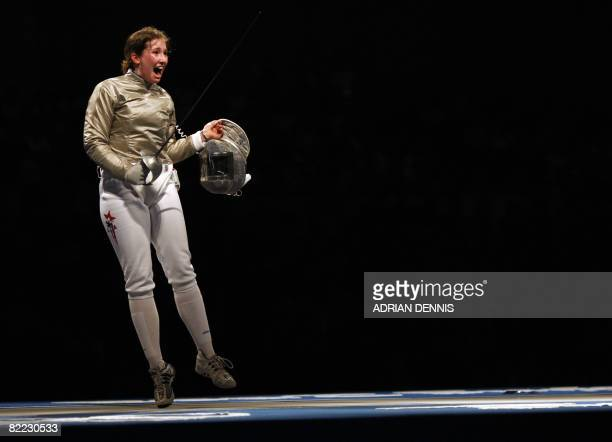 US Becca Ward celebrates her victory over Russian Federation's Sofiya Velikaya at the end of their women's individual sabre third place final match...