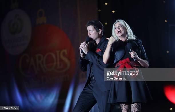 Beccy Cole and Adam Harvey perform I'll Be Home for Christmas during the Woolworths Carols in the Domain on December 17 2017 in Sydney Australia...