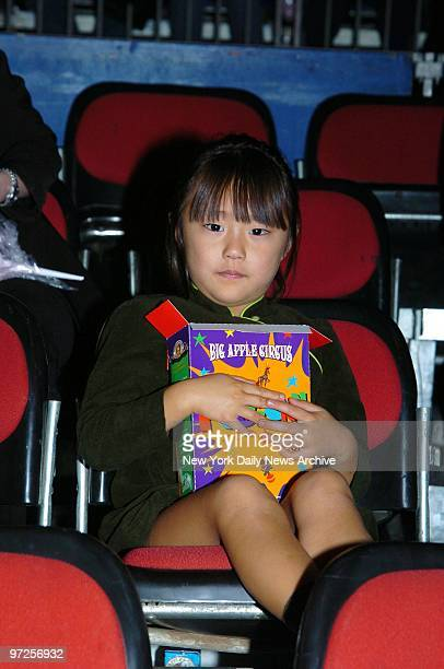 Bechet Dumaine Allen the daughter of Woody and SoonYi Allen holds tight to her box of popcorn at the Big Apple Circus' opening night gala benefit in...