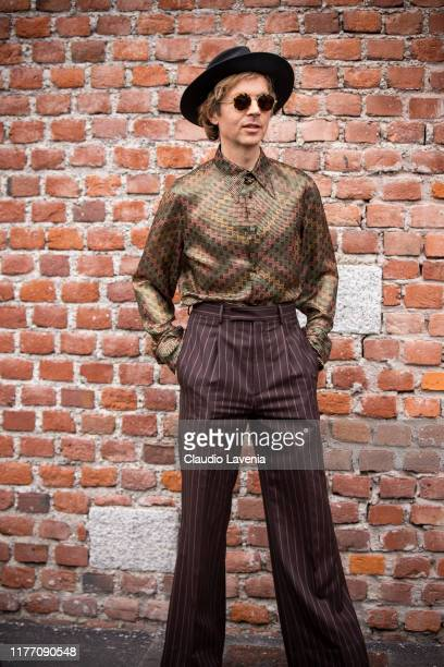 Beck Hansen wearing printed shirt brown striped pants and black hat is seen outside the Gucci show during Milan Fashion Week Spring/Summer 2020 on...