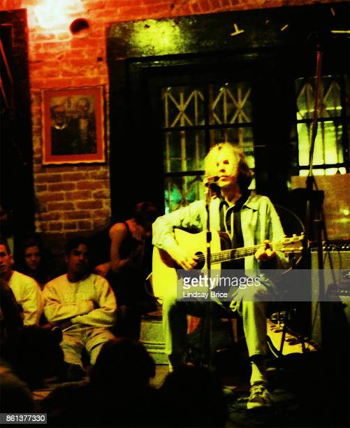 Beck performs on acoustic guitar with Chris Ballew on electric accompanied by percussionist on washtub cardboard box and plastic water jug at Troy...
