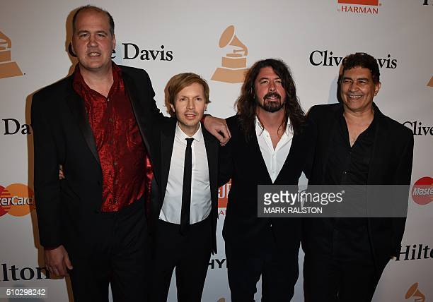 Beck poses for a photo with some of the original members of the band Nirvana including musician Dave Grohl as they arrive for the Clive Davis The...