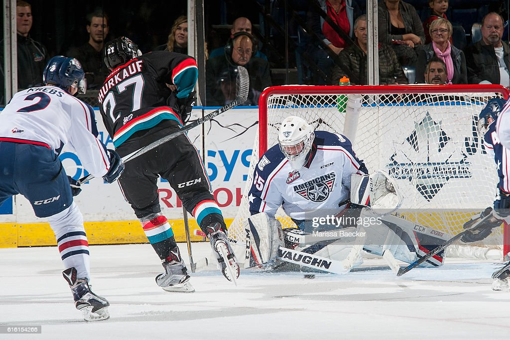 Beck Warm #35 of the Tri-City Americans makes a save on a shot by Calvin Thurkauf #27 of the Kelowna Rockets on October 21, 2016 at Prospera Place in Kelowna, British Columbia, Canada.