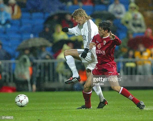Beckham of Real Madrid and Pedro Marti of Sevilla in action during the Spanish Primera Liga match between Real Madrid and Sevilla at Santiago...