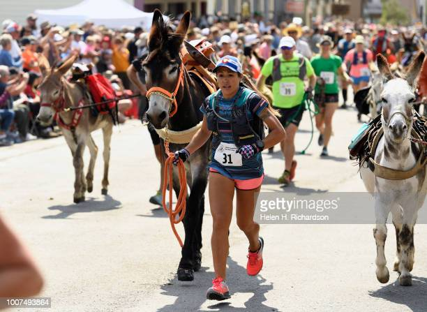 Becki Lynn Lassley of Littleton and her donkey Lil Turbo begin the 70th annual World Championship Pack Burro Race on July 29 in Fairplay Colorado...
