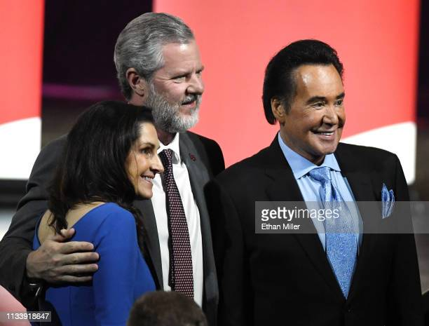 Becki Tilley Liberty University President Jerry Falwell Jr and entertainer Wayne Newton pose for a photo before a town hall meeting on the opioid...