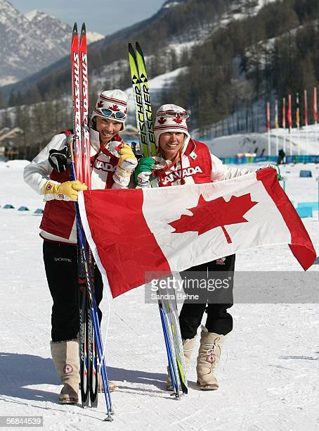 Beckie Scott and Sara Renner of Canada celebrate winning the Silver Medal for finishing second in the Womens Cross Country Skiing Team Sprint on Day...