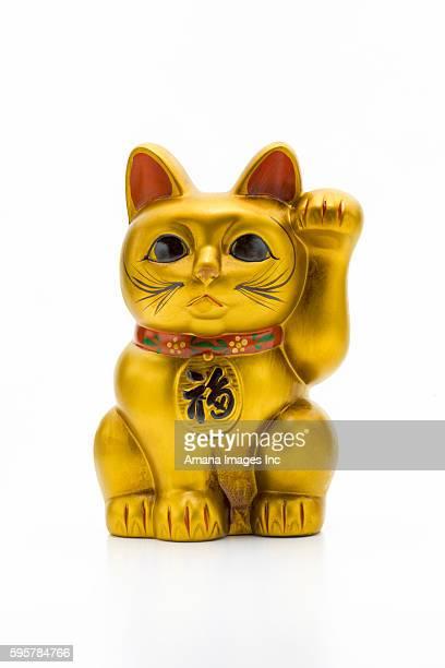 beckoning cat - maneki neko stock photos and pictures