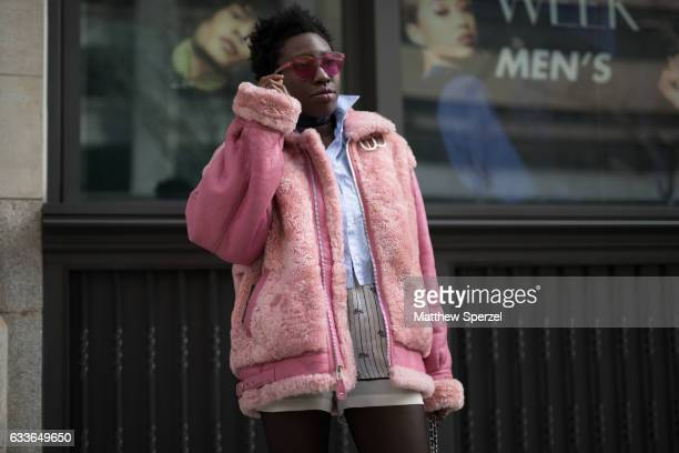Becky Akinyode is seen attending Palomo Spain while wearing a vintage jacket courtesy of Halley Wollens Palmer Harding shirt and vintage shorts on...