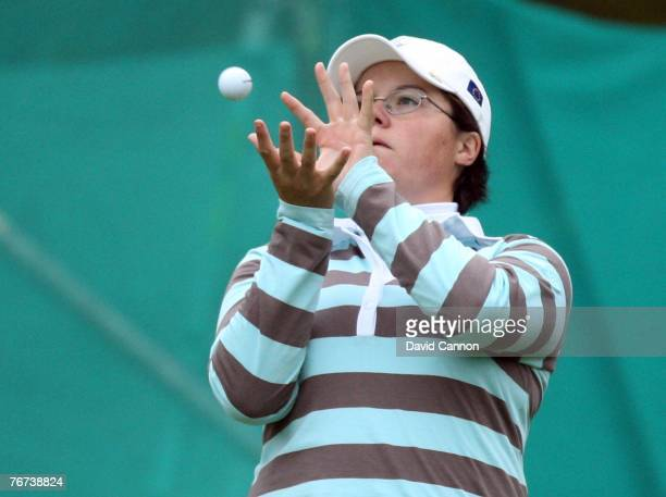 Becky Brewerton of the European Team catches the ball beside the green at the 8th hole during the morning foursomes matches of the 2007 Solheim Cup,...