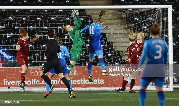 Becky Flaherty of Liverpool Ladies goes up with Vivianne Miedema of Arsenal Women during the Women's Super League match between Liverpool Ladies and...