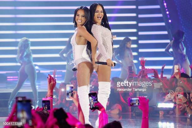 Becky G and Natti Natasha perform on stage at Univision's Premios Juventud 2018 at Watsco Center on July 22 2018 in Coral Gables Florida