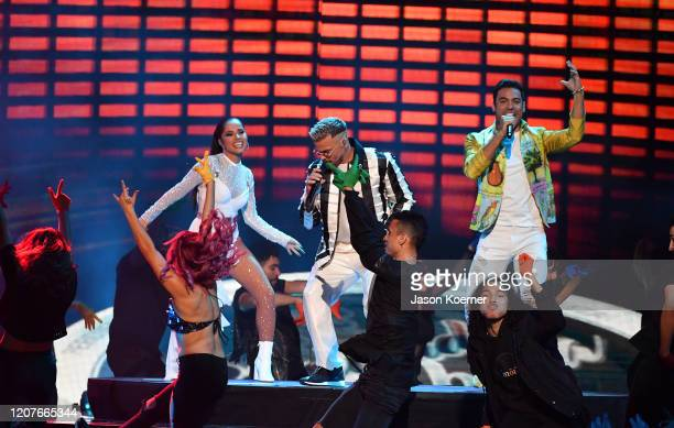 Becky G Pedro Capo and Carlos Rivera perform live on stage during Univision's Premio Lo Nuestro 2020 at AmericanAirlines Arena on February 20 2020 in...
