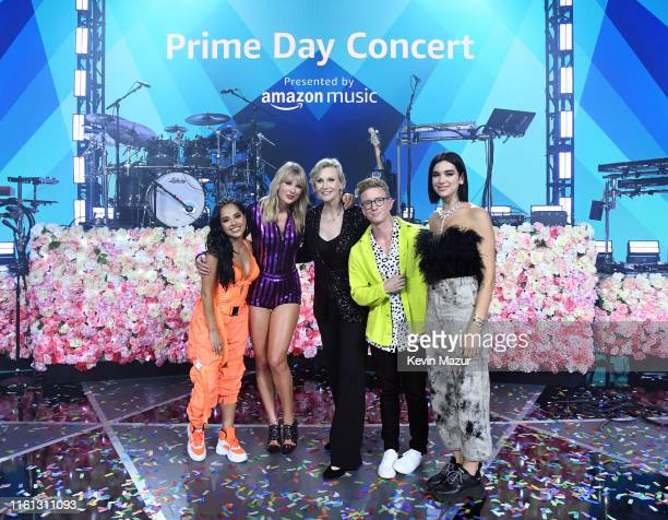 Becky G Taylor Swift Jane Lynch Tyler Oakley and Dua Lipa pose onstage as Taylor Swift Dua Lipa SZA and Becky G perform at The Prime Day concert...