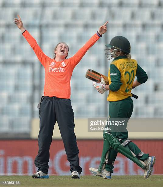 Becky Grundy of England celebrates dismissing Mignon du Preez of South Africa during the ICC Womens World Twenty20 Bangladesh 2014 semi final between...