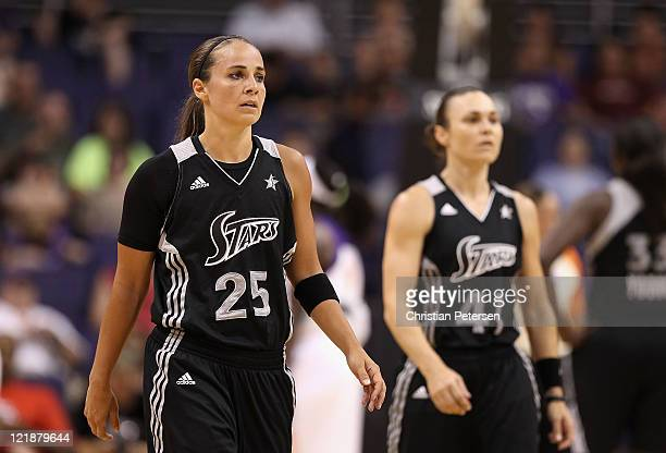 Becky Hammon and Tully Bevilaqua of the San Antonio Silver Stars walk back to their bench during the WNBA game against the Phoenix Mercury at US...