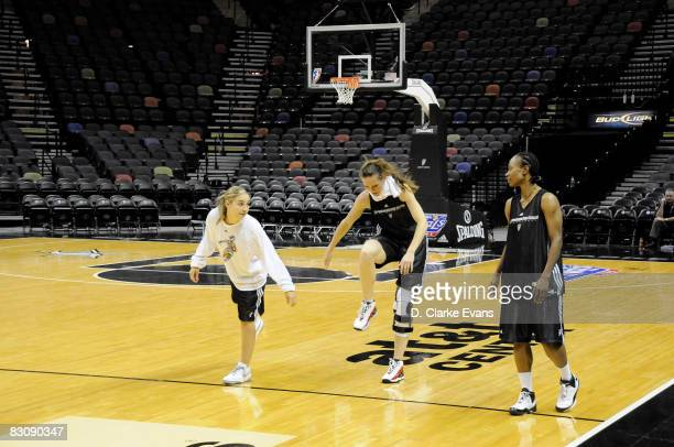 Becky Hammon Erin Buecher and Vickie Johnson of the San Antonio Silver Stars practice during media availability after Game One of the WNBA Finals on...