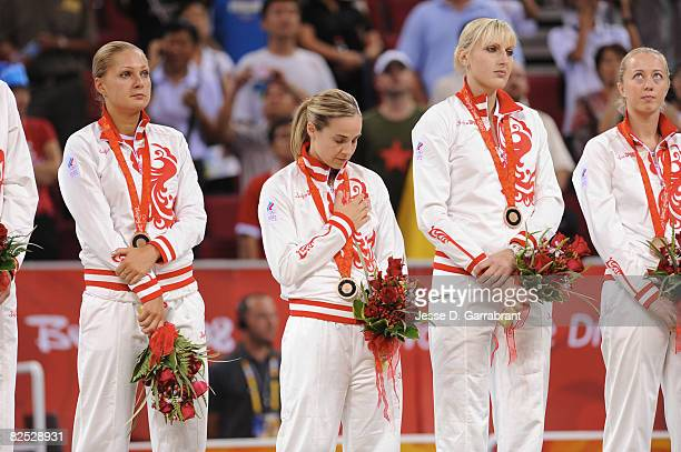 Becky Hammon of Russia celebrates on the podium after winning the women's bronze medal at the 2008 Beijing Olympic Games at the Beijing Olympic...