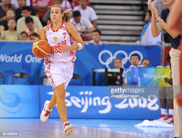 Becky Hammon of Russia drives against the US Women's Senior National Team during the women's semifinals basketball game at the 2008 Beijing Olympic...
