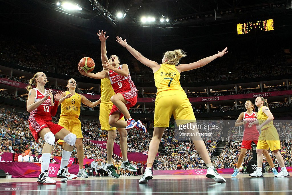 Becky Hammon #9 of Russia drives for a shot attempt against Abby Bishop #7 of Australia during the Women's Basketball Bronze Medal game on Day 15 of the London 2012 Olympic Games at North Greenwich Arena on August 11, 2012 in London, England.