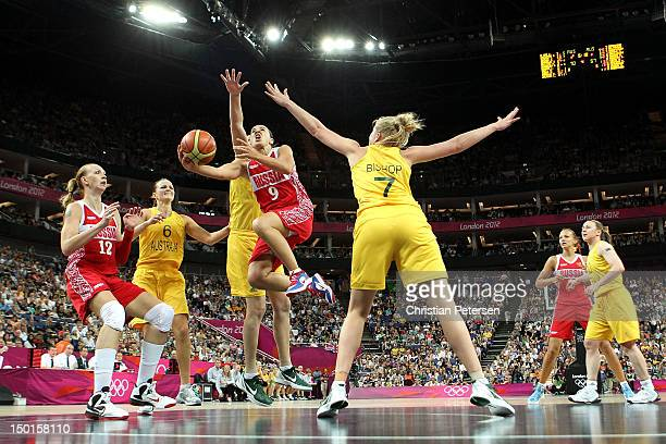 Becky Hammon of Russia drives for a shot attempt against Abby Bishop of Australia during the Women's Basketball Bronze Medal game on Day 15 of the...