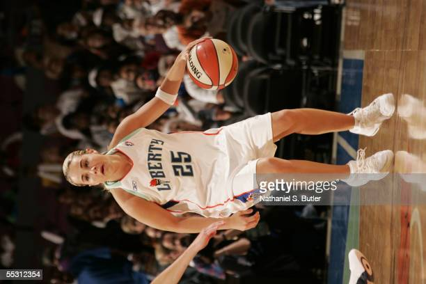 Becky Hammon of the New York Liberty handles the ball in Game One of the first round of the Eastern Conference playoffs against the Indiana Fever...