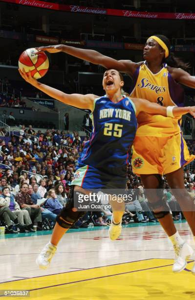 Becky Hammon of the New York Liberty shoots against the DeLisha MiltonJones of the Los Angeles Sparks during the game at Staples Center on June 29...