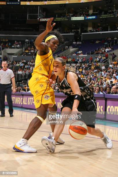 Becky Hammon of the San Antonio Silver Stars dribbles against Marie FerdinandHarris of the Los Angeles Sparks during their game on July 14 2008 at...