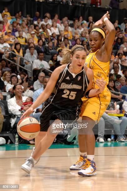 Becky Hammon of the San Antonio Silver Stars dribbles past Tameka Johnson of the Los Angeles Sparks on August 30 2008 at Staples Center in Los...