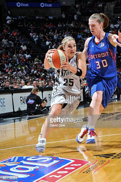 Becky Hammon of the San Antonio Silver Stars drives against Katie Smith of the Detroit Shock in Game Two of the WNBA Finals on October 3 2008 at ATT...