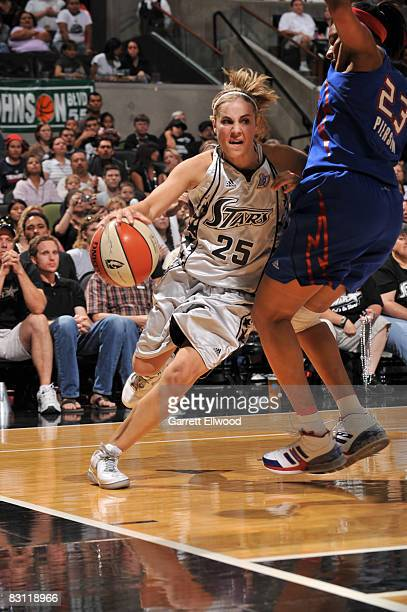 Becky Hammon of the San Antonio Silver Stars drives against Plenette Pierson of the Detroit Shock during Game Two of the WNBA Finals on October 3...
