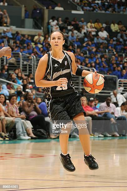 Becky Hammon of the San Antonio Silver Stars drives the ball to the basket during the WNBA game against the Los Angeles Sparks on August 4 2009 at...