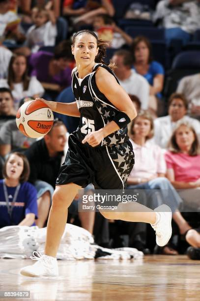 Becky Hammon of the San Antonio Silver Stars drives the ball up court during the WNBA game against the Phoenix Mercury on June 6 2008 at US Airways...