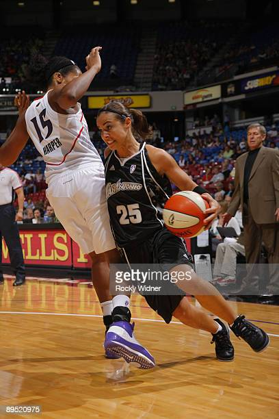 Becky Hammon of the San Antonio Silver Stars drives to the basket around Laura Harper of the Sacramento Monarchs on July 30 2009 at ARCO Arena in...