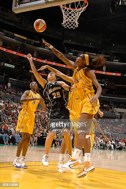 Becky Hammon of the San Antonio Silver Stars has her shot contested by Lisa Leslie of the Los Angeles Sparks on August 30 2008 at Staples Center in...