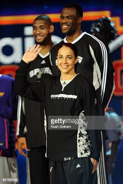Becky Hammon of the San Antonio Silver Stars is introduced as she participates with Tim Duncan of the San Antonio Spurs and former San Antonio Spur...