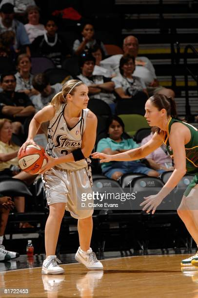 Becky Hammon of the San Antonio Silver Stars looks to pass the ball against Sue Bird of the Seattle Storm during the WNBA game on June 13 2008 at the...