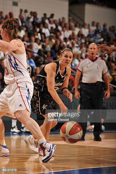 Becky Hammon of the San Antonio Silver Stars passes against the Detroit Shock during Game Three of the WNBA Finals on October 5 2008 at the Eastern...
