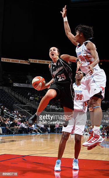 Becky Hammon of the San Antonio Silver Stars puts up a shot against Angel McCoughtry of the Atlanta Dream at Philips Arena on August 20 2009 in...